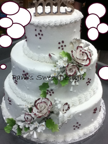 Wedding Cake: white with burgandy and white dots and burgandy tipped flowers.
