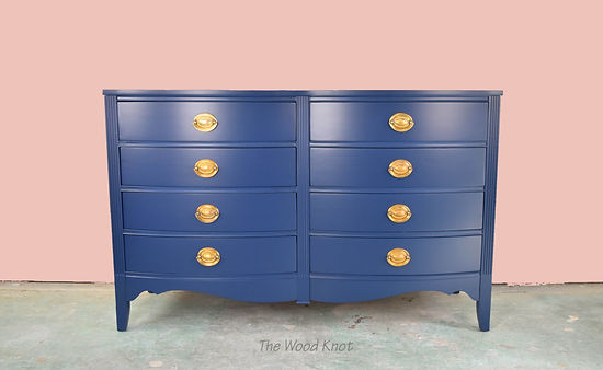 Blue refinised sideboard and brass handles. Pink wall nursery