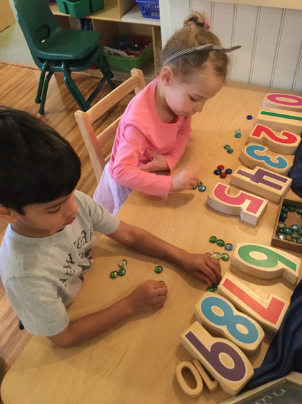 children using counters and numbers cks