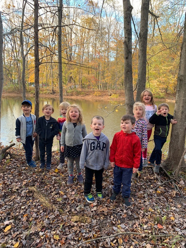 children by the lake in the fall