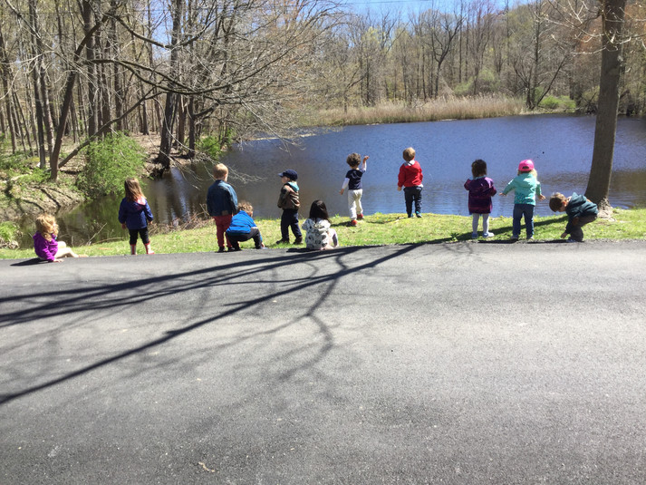 children learning by the lake