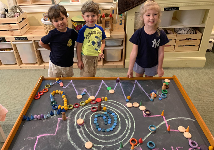 children showing off teir work cks