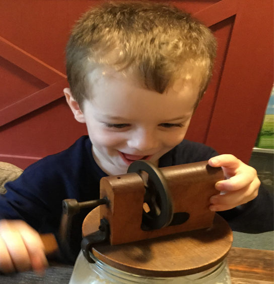 child playing with mechanical wheels cks