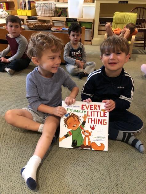 boys sharing a book cks
