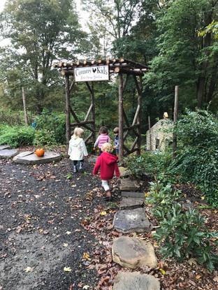 kids folllowing a stony path