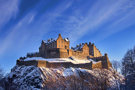 Edinburgh castle dusted with snow glows