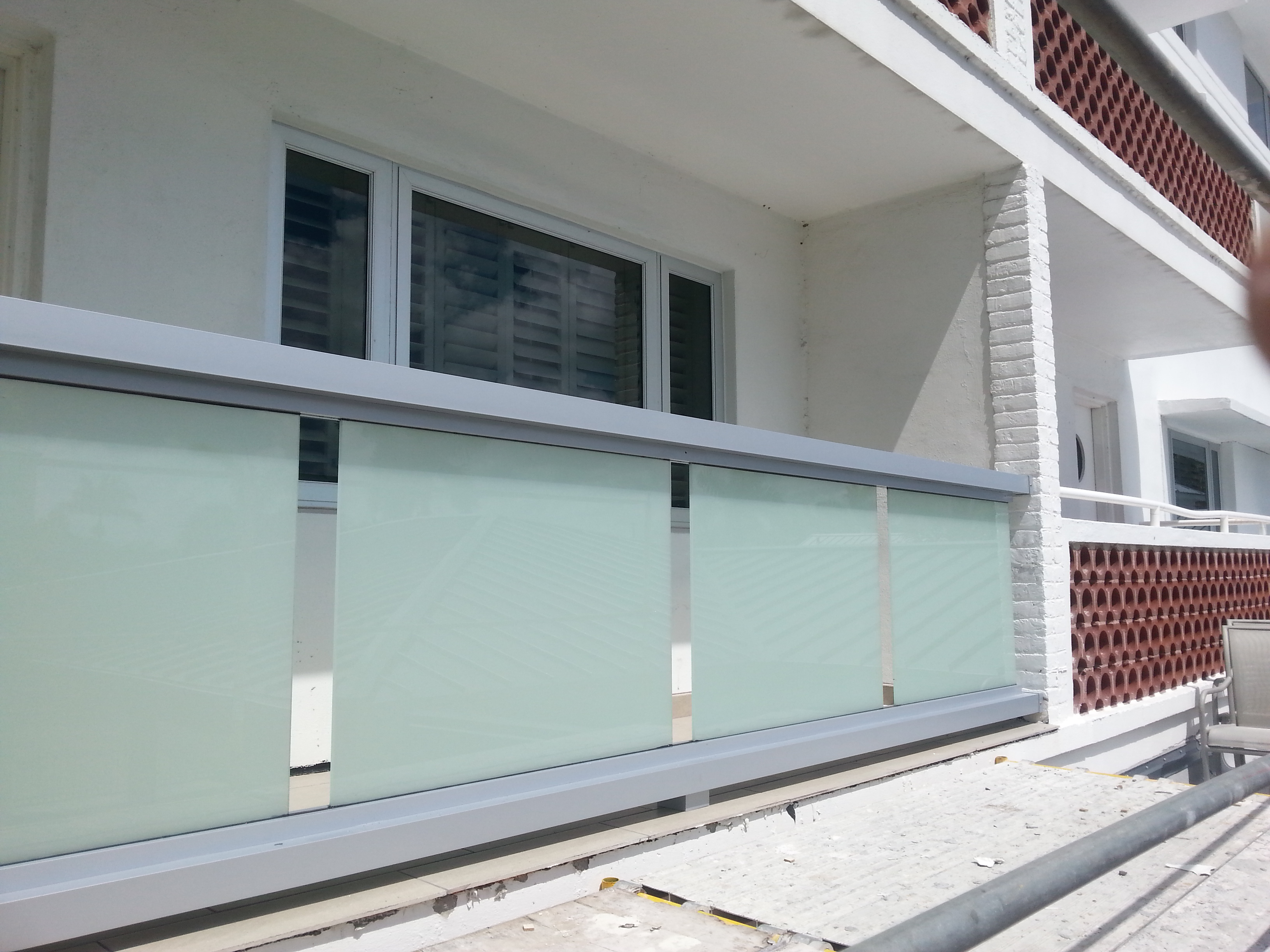 Glass panel railings on balcony