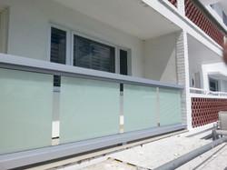 Glass panel railings on balcony