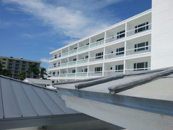Metal roof and hotel rooms