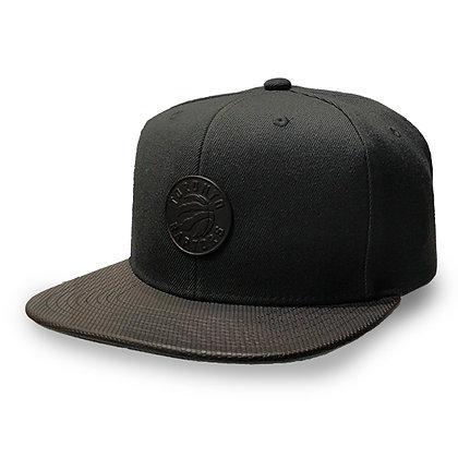 Men's Toronto Raptors Mitchell and Ness All Black/ Leather Visor Snapback