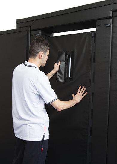 black wall system cell door window.jpg