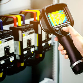 technician use thermal imaging camera to