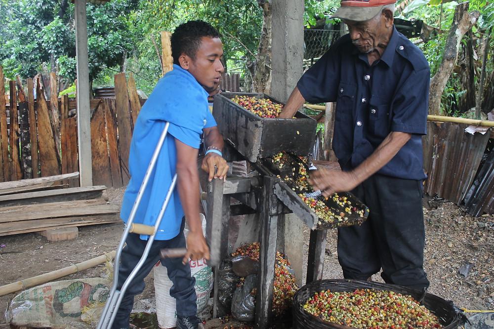 Photo: An RHTO staff member helps a RHTO member grind coffee.  Credit: RHTO