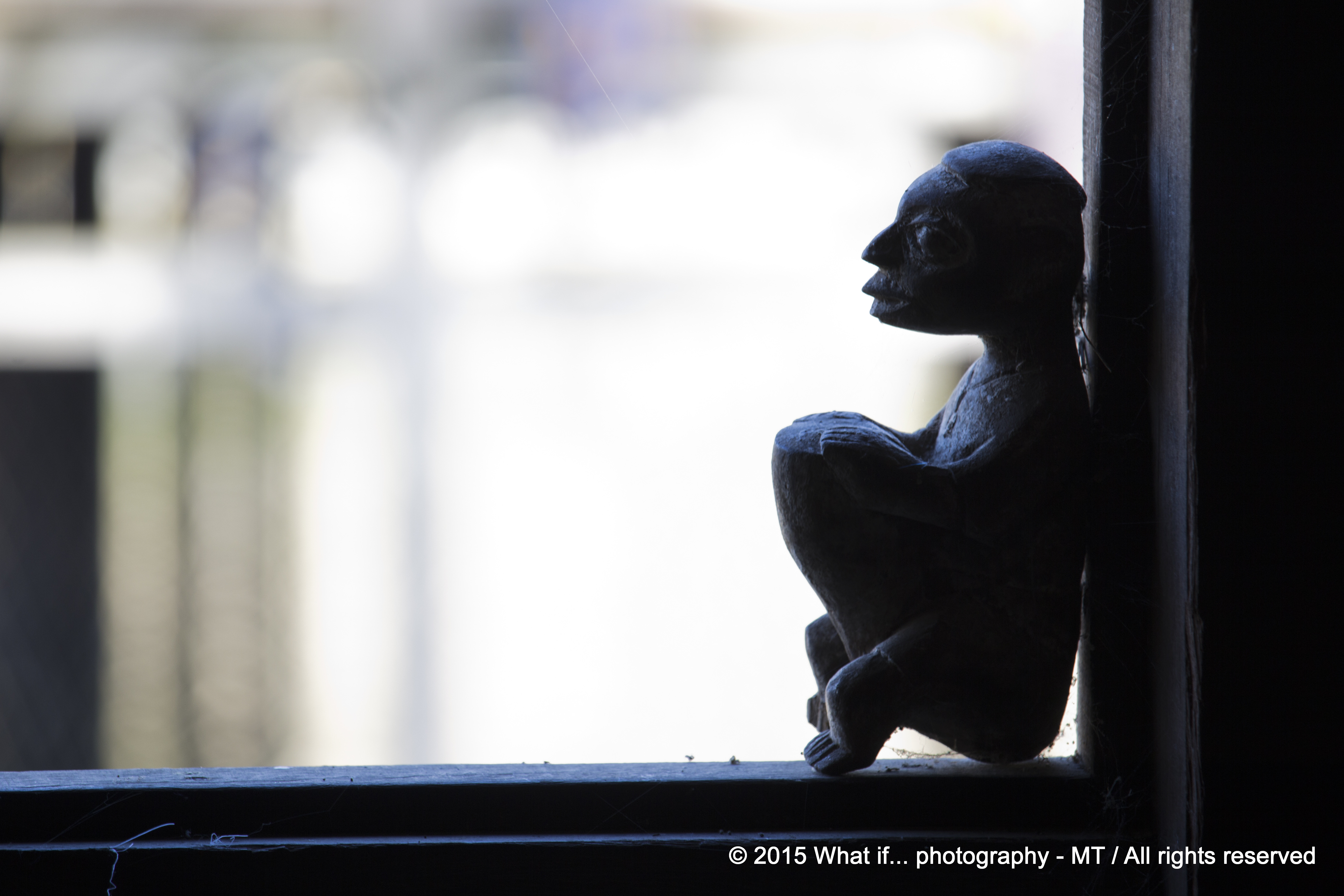 Wooden statue on a window