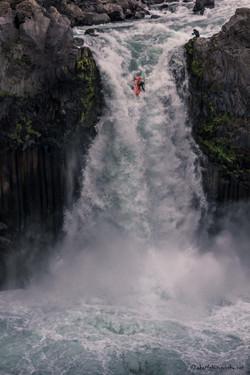 Kayak jumping of Aldeyjarfoss waterfall,