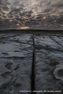 Cross-shaped crack in limestone at sunrise, Doolin (Ireland)