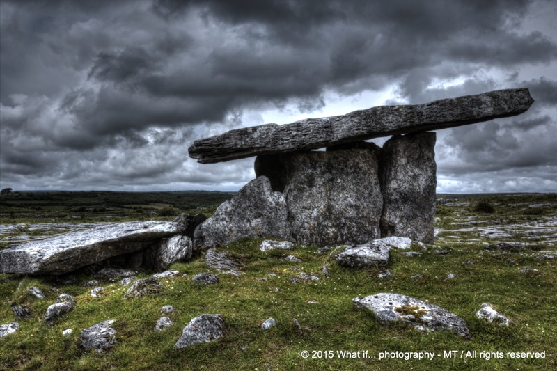 Poulnabrone dolmen, the Hole of Sorrows with apocalyptic sky, Clare (Ir