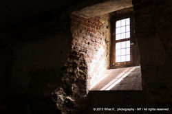 Light falling into a dark cellar through a small window of hope