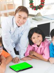 101628557-asian-teacher-and-three-kids-e