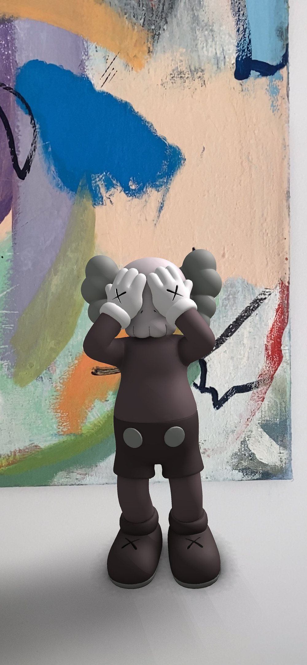 AT HIS TIME (EXPANDED) AR Sculpture by KAWS in front of painting by Sophie Heinrich