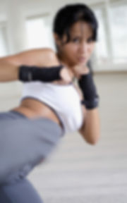 Woman kickboxing training