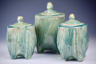 Green jars with lids