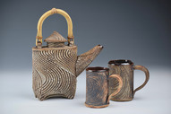 Teapot with bamboo handle, two mugs