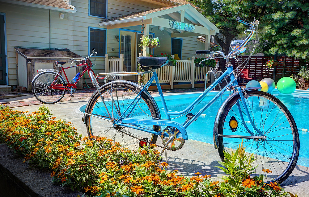 Bicycles by pool and Pool House