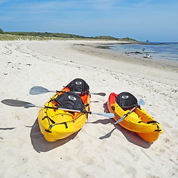 Single and double kayaks on Par Beach St Martin's