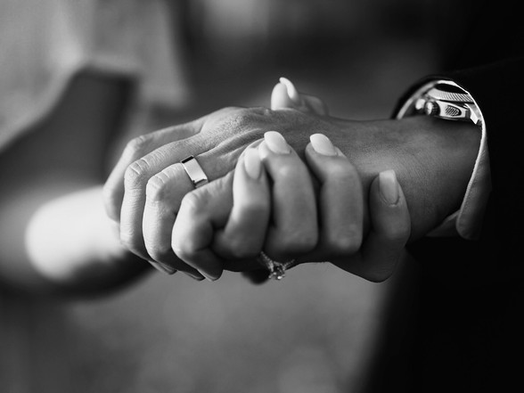 a black and white photo of hands