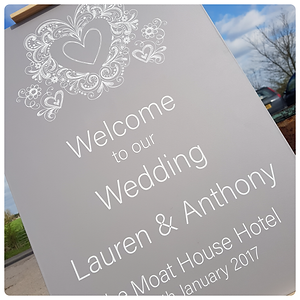 Pretty 'welcome to our wedding' sign with grey colour scheme and doodle heart design