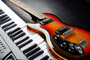 Music keyboard and electric guitar..jpg