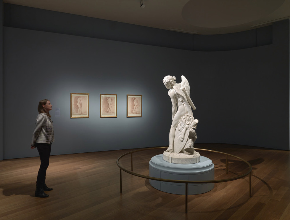 Cupid installed dramatically in the center of the exhibition.
