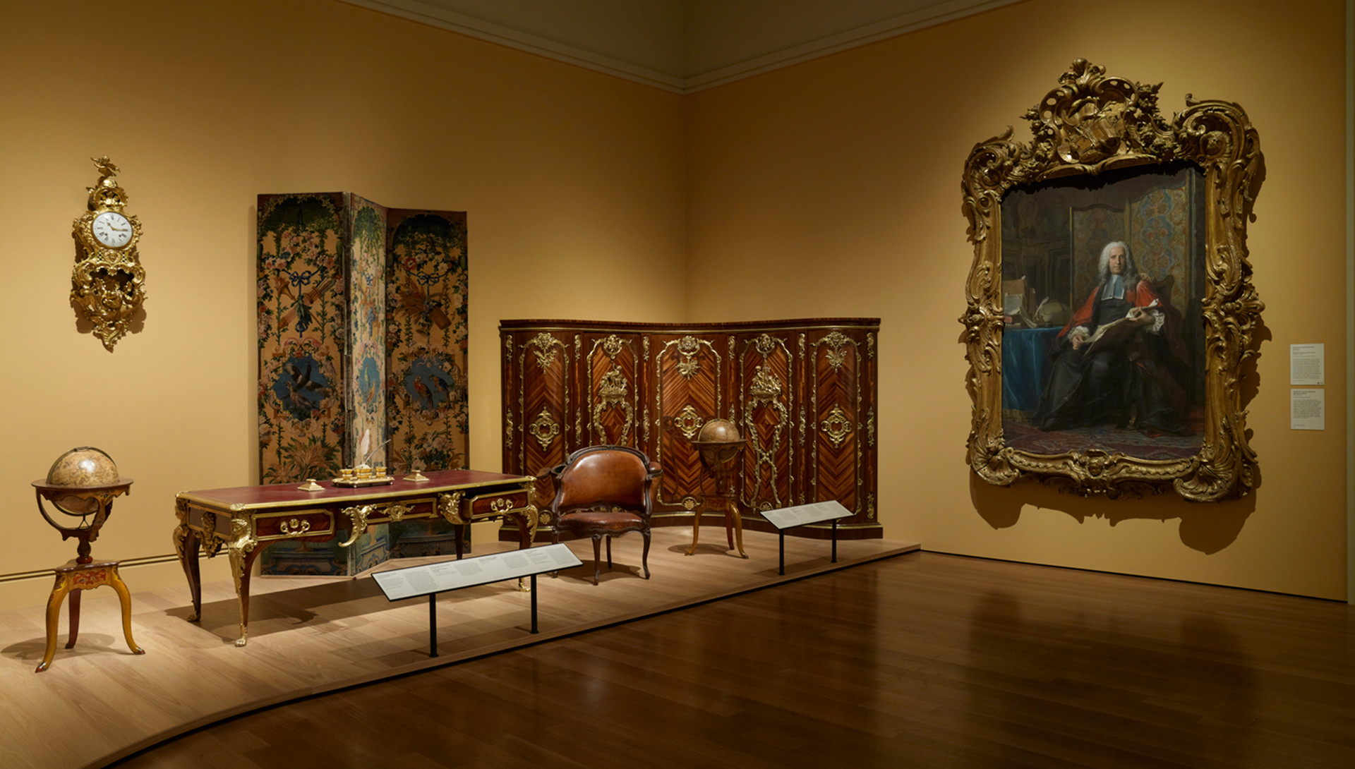 Objects were arranged either by historical context or to mimic the actual paintings on view in the gallery.