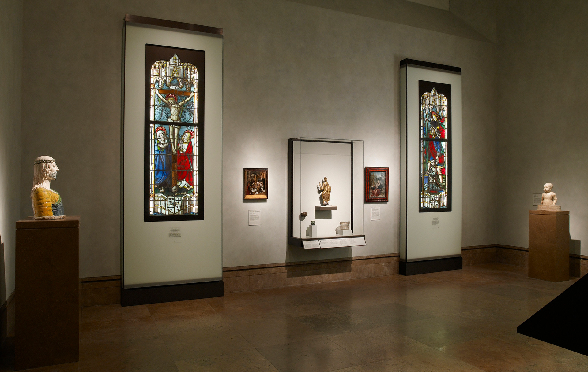 Fabricated in Belgium the twelve foot high display cases for the Getty's collection of stained glass featured frosted glass facades and state-of-the-art fiber optic lighting.