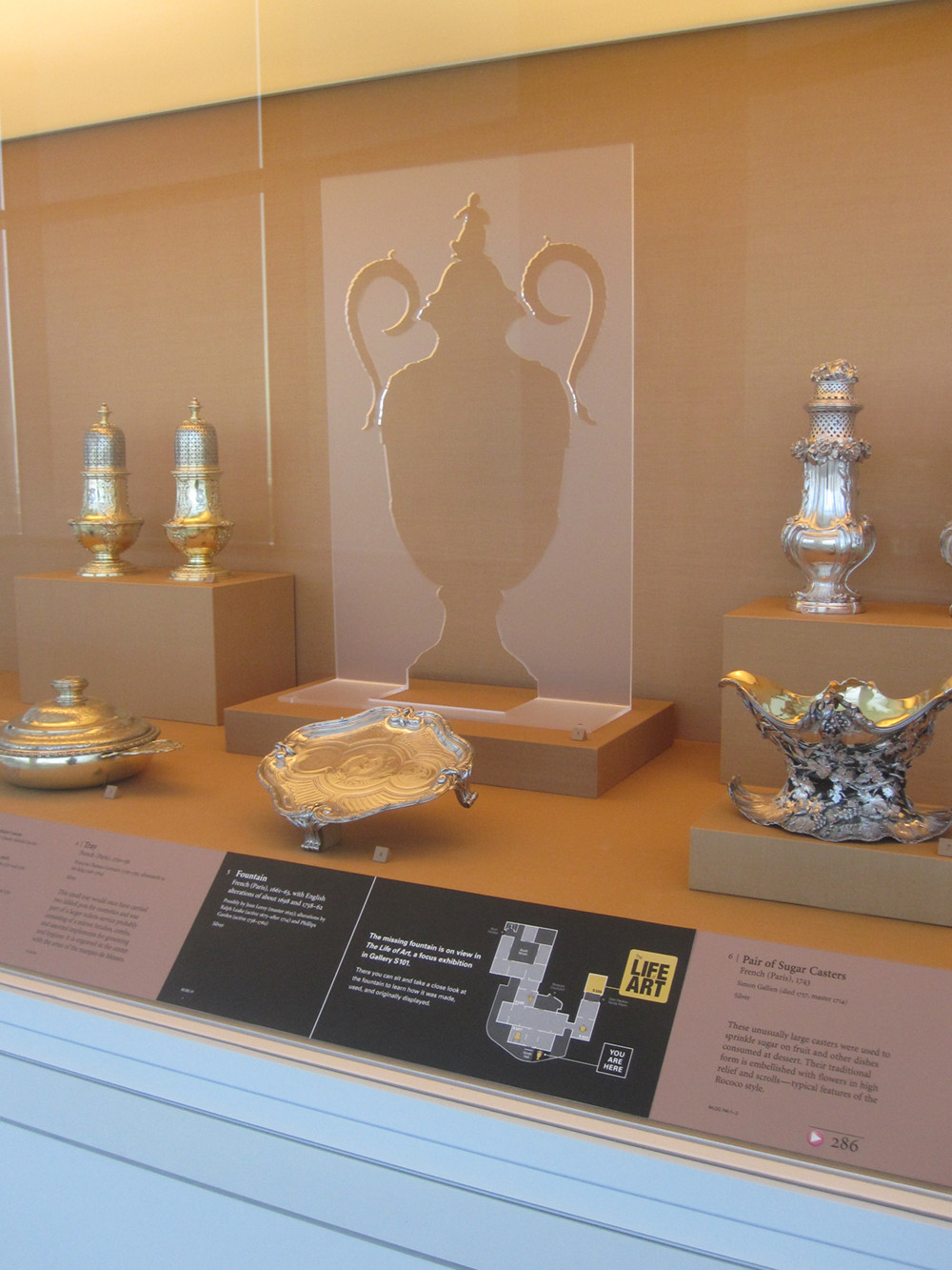 Plexi silhouettes indicated where the object had been in the permanent collection and promoted the exhibition.