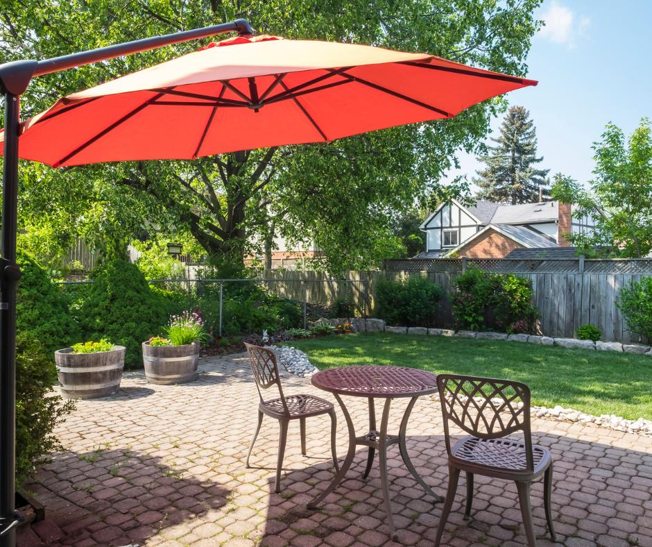 Orange Cantilever umbrella shades patio