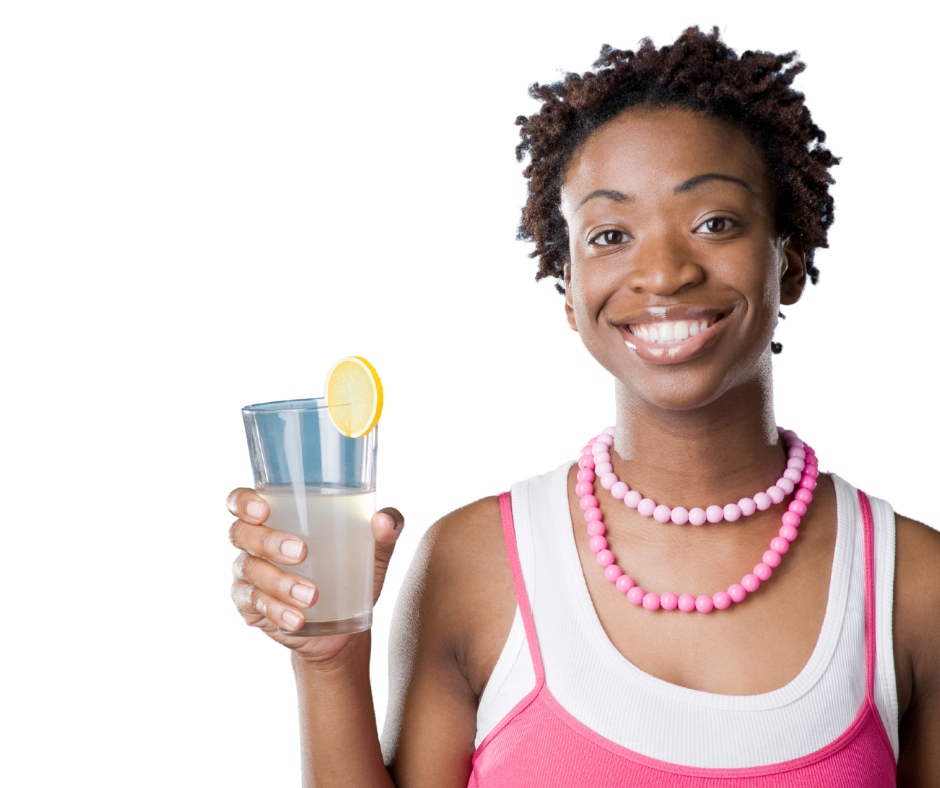 Pretty woman of colour holding glass of cold lemonade