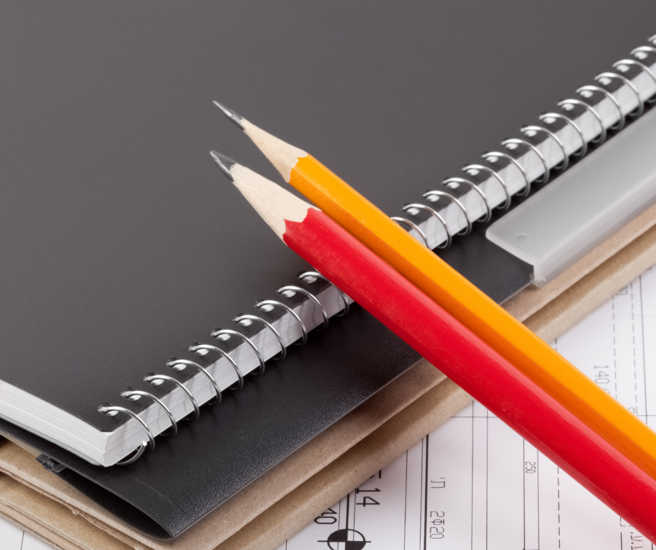 Spiral notebook, folder and two pencils