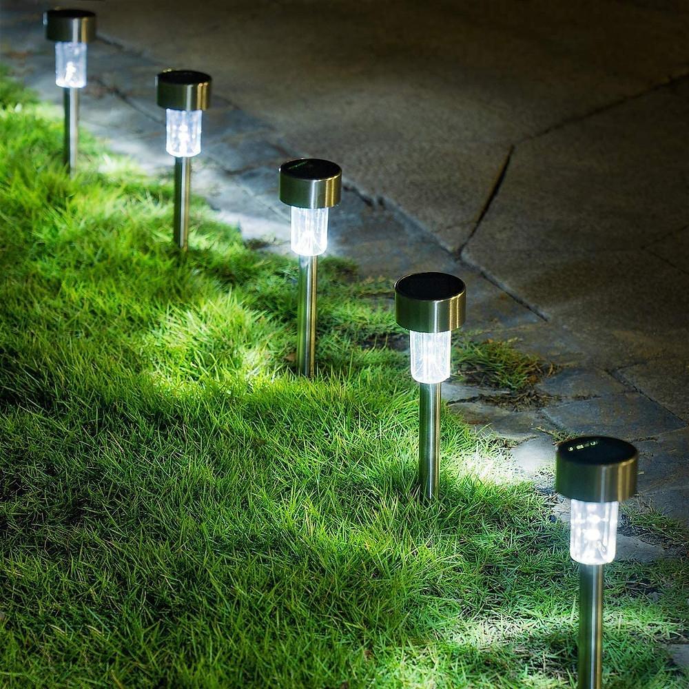 Solar garden lights illuminate walkway