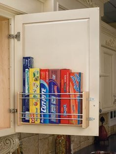 Slim Shelf on back of Kitchen Cabinet Holds Boxes of Foil and Plastic Wrap