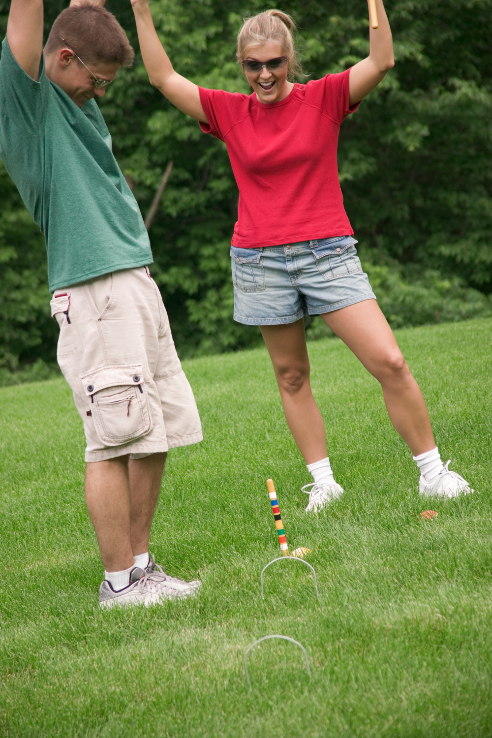 Excited couple Playing Croquet