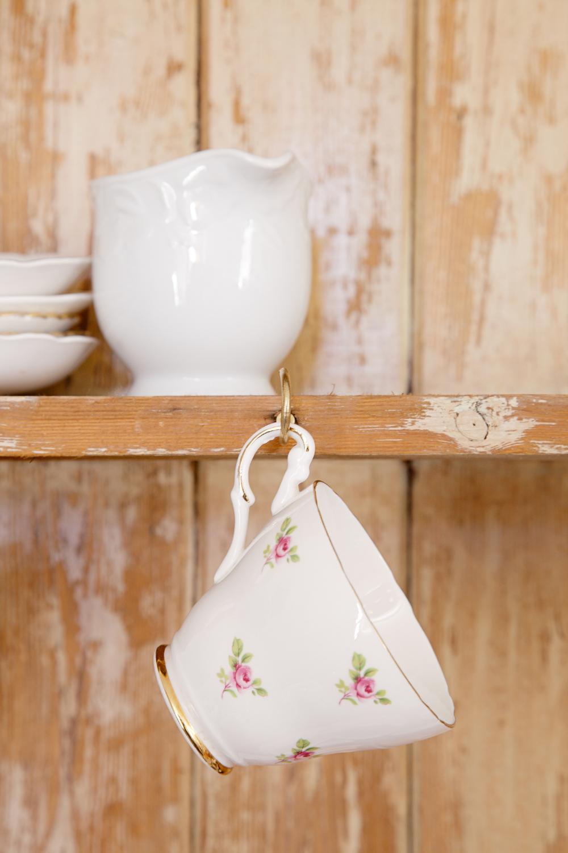 Pretty Cups Hanging below Shelf