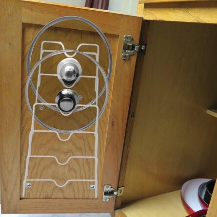 Pot lid rack on back of cupboard door