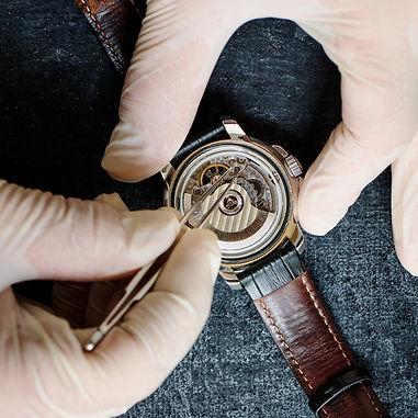 watchmaker-repairing-old-wristwatch-top-view.jpg