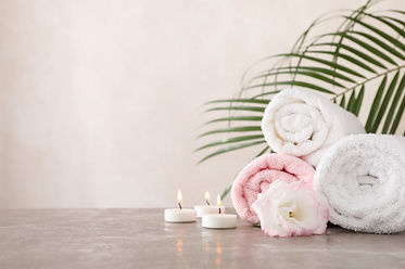 towels-candles-flower-grey-background-sp