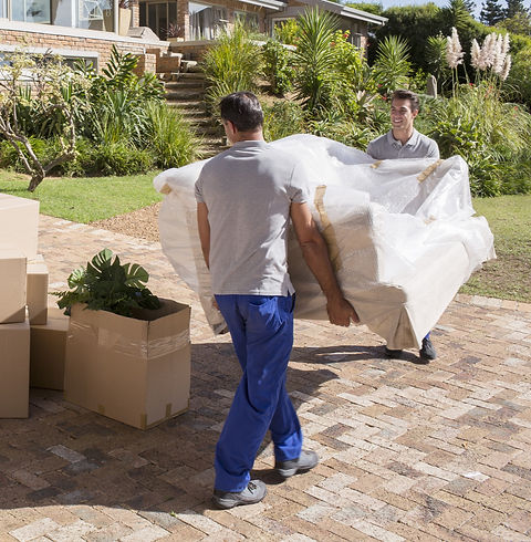 men lifting a wrapped sofa