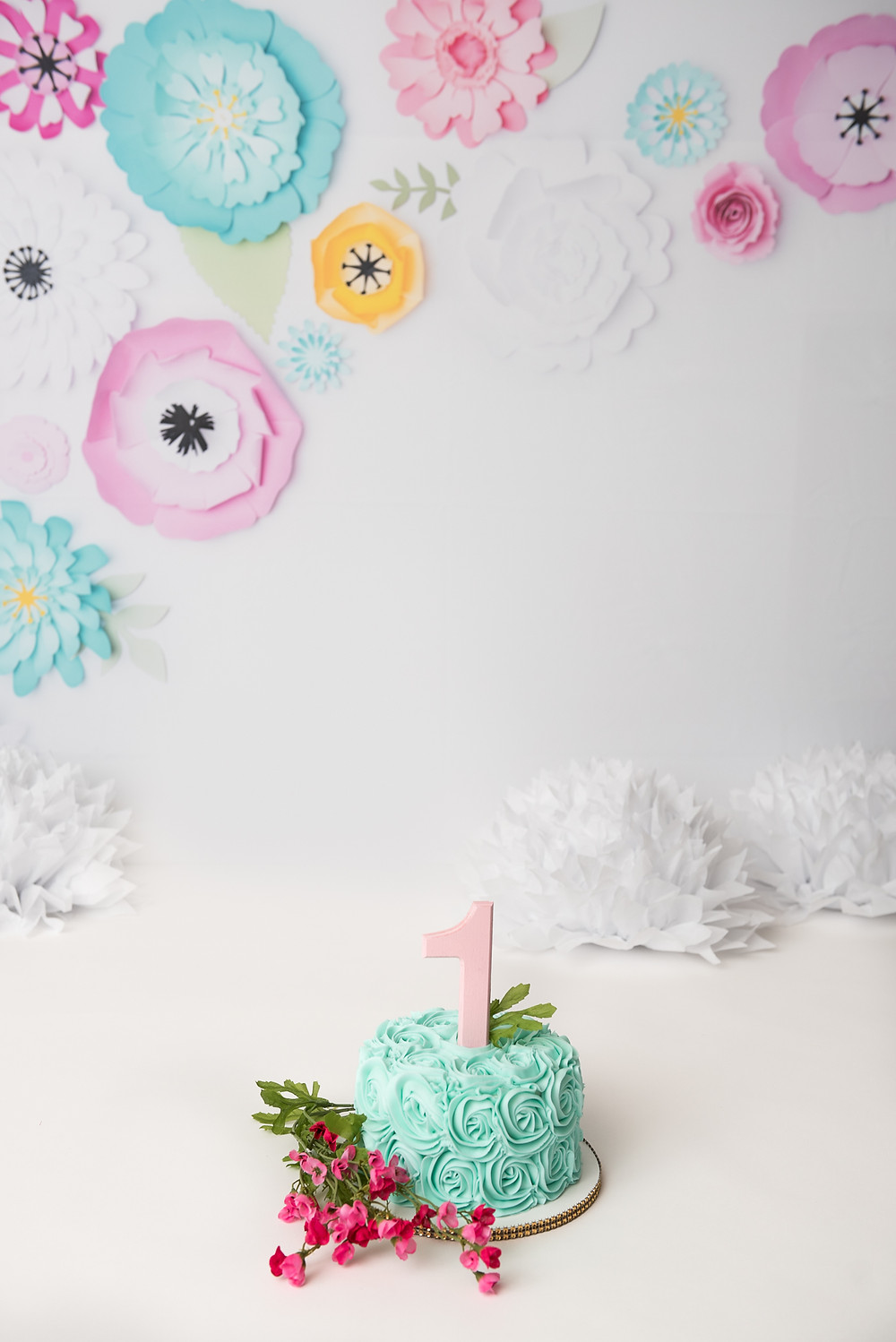 Long Island cake smash for 1st birthday baby girl with pink and aqua flowers