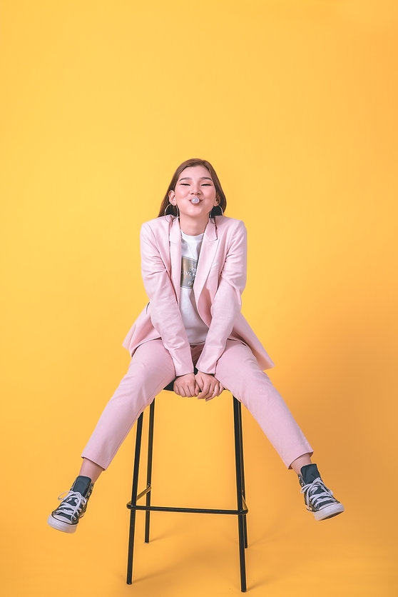 woman-in-pink-suit-sitting-on-stool-3737
