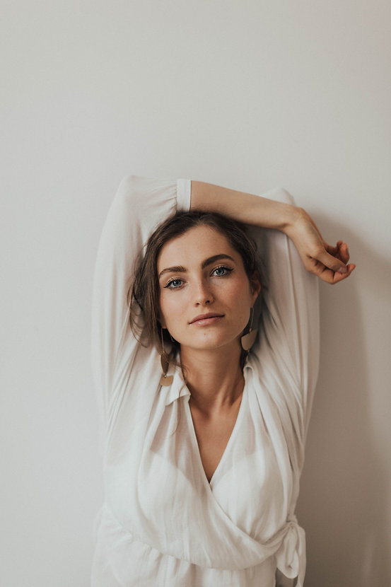 photo-of-woman-in-white-v-neck-long-slee